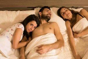 heterosexual couple in bed